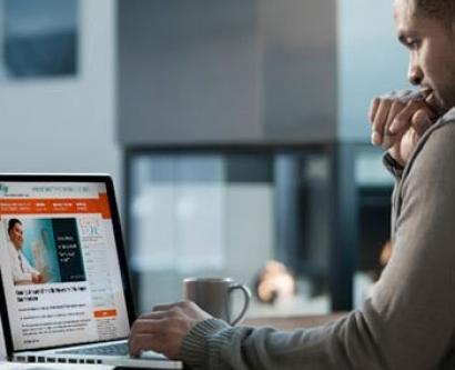Man viewing website on laptop