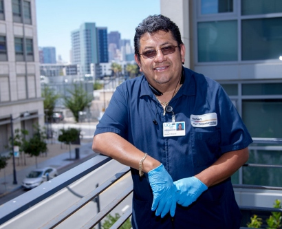 Herbert Menjivar standing on a balcony at Mission Bay
