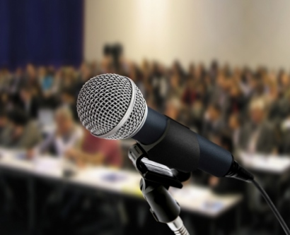 stock image of a microphone at a town hall meeting