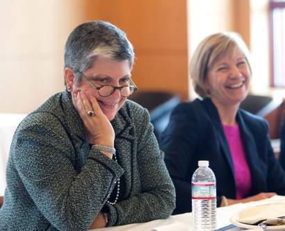 UC President Janet Napolitano and UCSF Chancellor Susan Desmond-Hellmann laugh at a joke during a lunchtime discussion with students on Nov. 18..