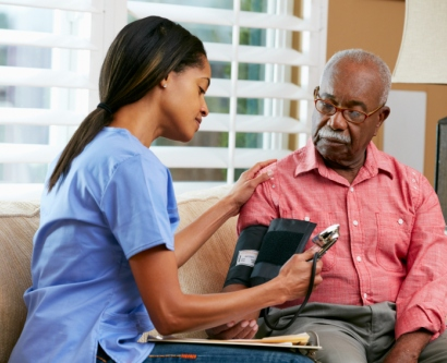 Stock image of nurse taking man's blood pressure