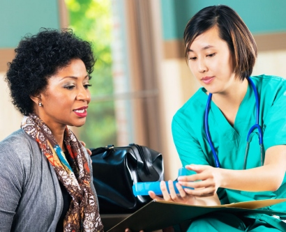 stock image of medical professional explaining medication dosage to a patient