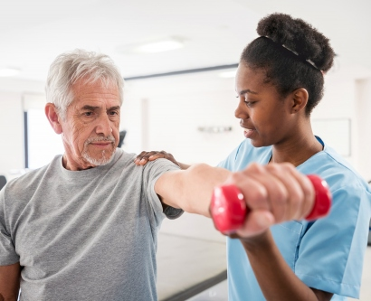 Physical therapy patient lifting arm with weight