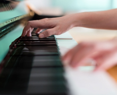 stock image of hands playing a piano