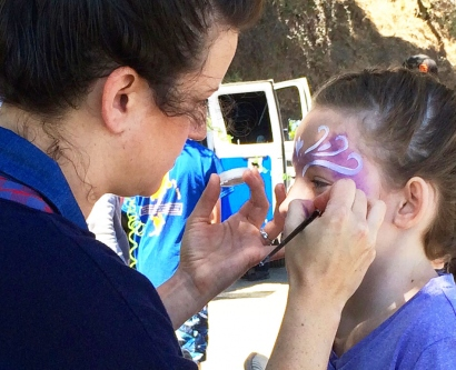 A girl gets her face painted during the UCSF Pediatric Transplant Picnic.