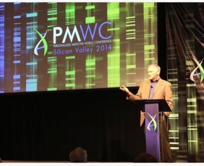 speaker at podium at the Personalized Medicine World Conference