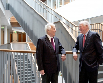 Stanley Prusiner and David Ramsay chat with each other at UCSF's Mission Bay campus