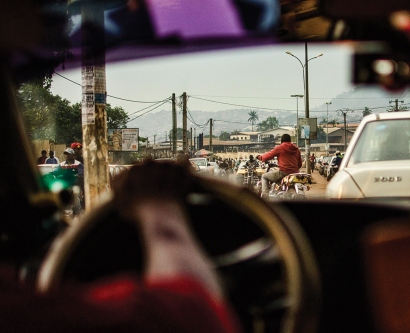 View from the driver's seat of a car in a developing country