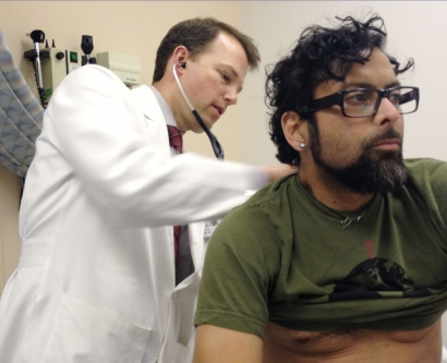 Dr. Steven Hays examines double lung transplant recipient Rowan Jimenez at UCSF Medical Center.