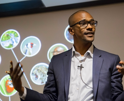 Sama Ahmed, winner of the grand prize in the Three Minute Thesis competition at UCSF, engages the crowd as he explains his thesis research