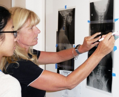 Catherine Chang helps Shelly Davis make a scoliosis diagnosis.