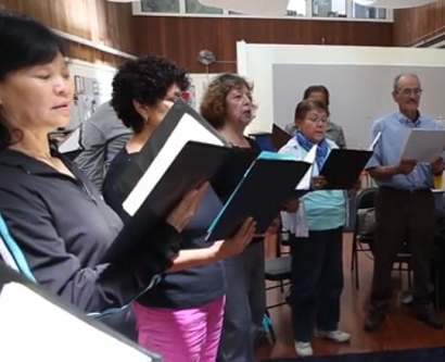 A seniors' community choir rehearses at the Mission Neighborhood Centers.
