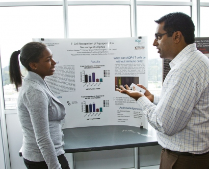 SEP intern Chelsea Stewart discusses her poster presentation with academic coordinator Kishore Hari in 2012.