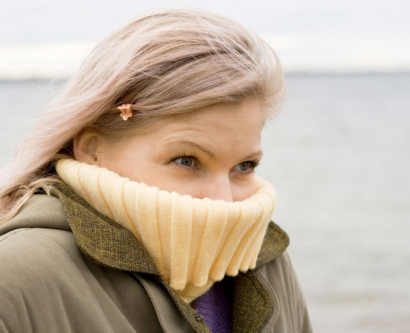 woman shivering in cold weather