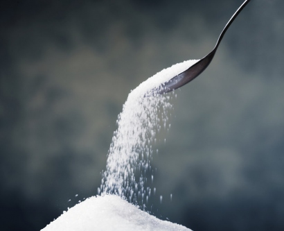 stock image of a sugar pouring out of a spoon