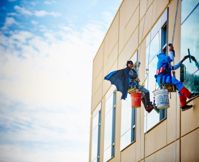 window washers dressed as superheroes scale the wall of UCSF Benioff Children's Hospital San Francisco