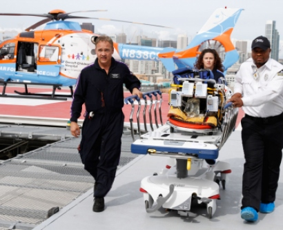 Staff do a test run of transporting a pediatric patient on the new Mission Bay hospital helipad.