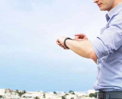 Man looking at his fitness tracker