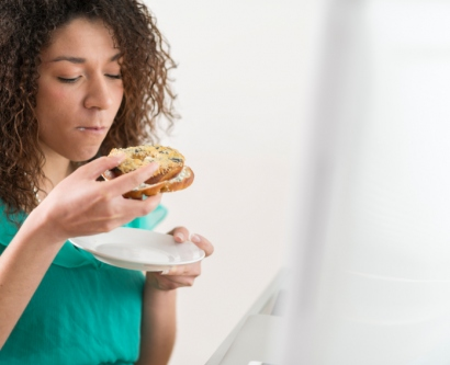 stressed woman eating a bagel