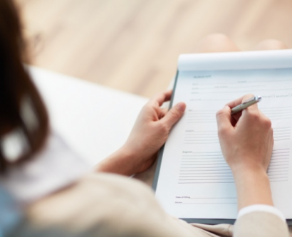 stock image of woman filling out a form