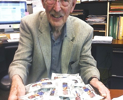 Bruce Ames holds a tray of CHORI-Bars