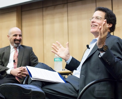 Drew Altman and Andrew Bindman talk in UCSF's Cole Hall during a presentation about health policies under the new administration