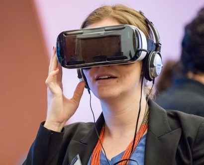 A woman wears a virtual-reality headset