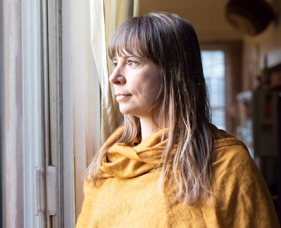 Eve Ekman looks out the window of her San Francisco home