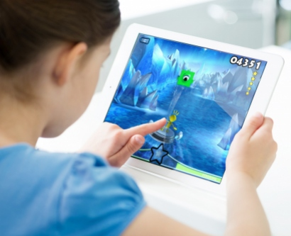 a child plays the EVO video game on a tablet