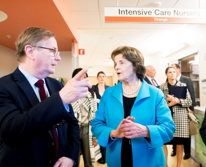 Dianne Feinstein walks with UCSF leaders on a hospital tour