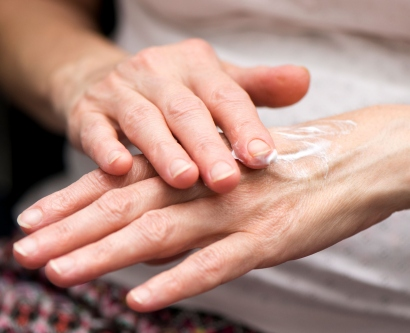 Hands rubbing lotion.