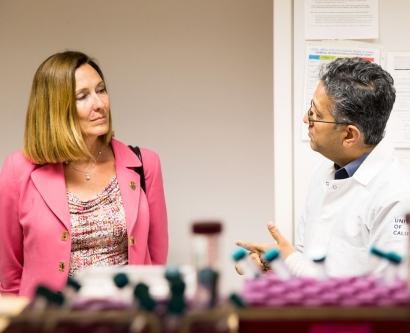 Jacqui Irwin talks with Shuvo Roy in a lab
