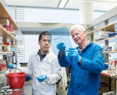 Kevin Shannon works with Benjamin Huang in a Mission Bay lab