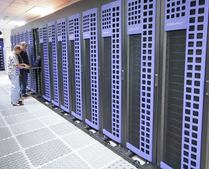 two people work a supercomputer inside of the Lawrence Livermore National Labratory