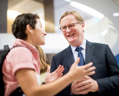 Chancellor Sam Hawgood mingles during a reception after the 2015 State of the University Address