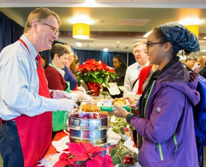 Chancellor Sam Hawgood serves breakfast at a Staff Appreciation Holiday Breakfast