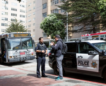 UCSF police officer talks to a man on the Parnassus campus