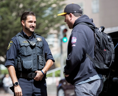 UCSF Police Officer Patrick Moncada talks with off-duty Sergeant Che Heron.