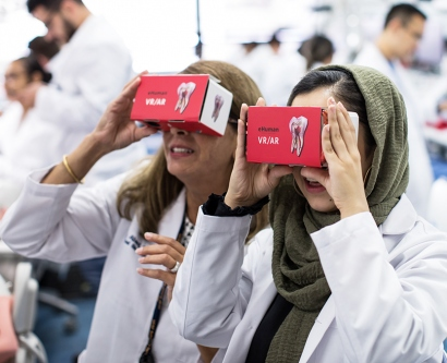 Nejleh Abed and Sara Soofianwith use virtual-reality headsets