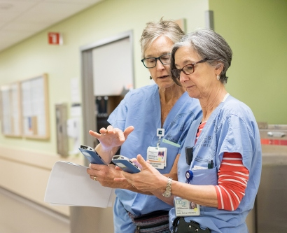 Therese Moran and Judith Bishop use handheld devices to monitor patients at the Betty Irene Moore Women's Hospital at Mission Bay