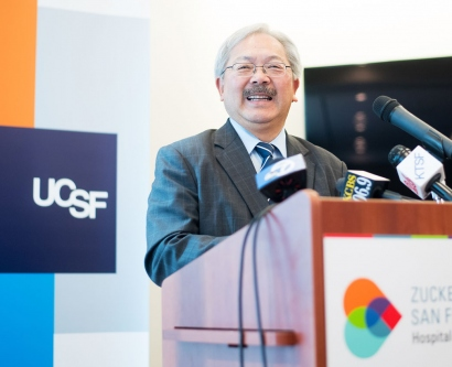 Mayor Ed Lee talks at the podium at a UCSF press conference