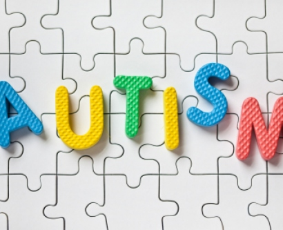 Autism spelled with colorful puzzle pieces.