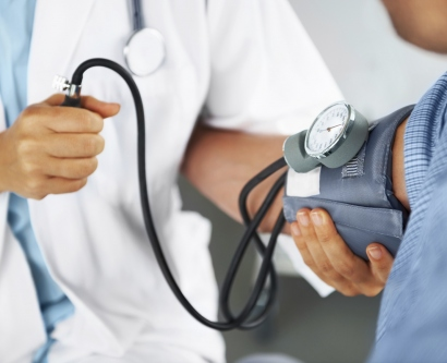 stock image of doctor checking patient's blood pressure