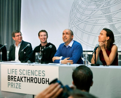 Susan Desmond-Hellmann, Arthur Levinson, Mark Zuckerberg, Yuri Milner, Anne Wojcicki sit as a panel during a press conference