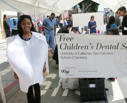 girl in tooth costume at dental fair