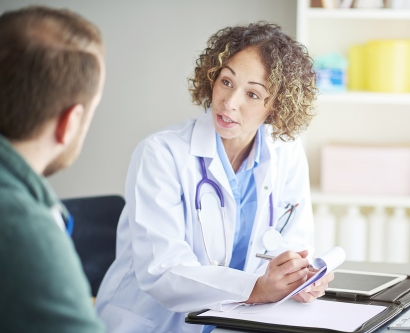 a female doctor talks with a patient