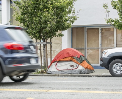 a homeless person's tent is seen on a street in San Francisco