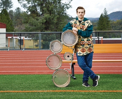 Oliver Bishop stands on the football field of his local high school