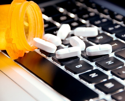 pills spilling onto computer keyboard