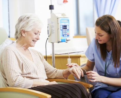 stock image of senior woman getting chemotherapy